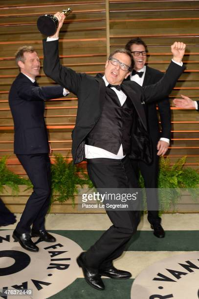 Director Spike Jonze director David O Russell and actor Johnny Knoxville attend the 2014 Vanity Fair Oscar Party hosted by Graydon Carter on March 2...
