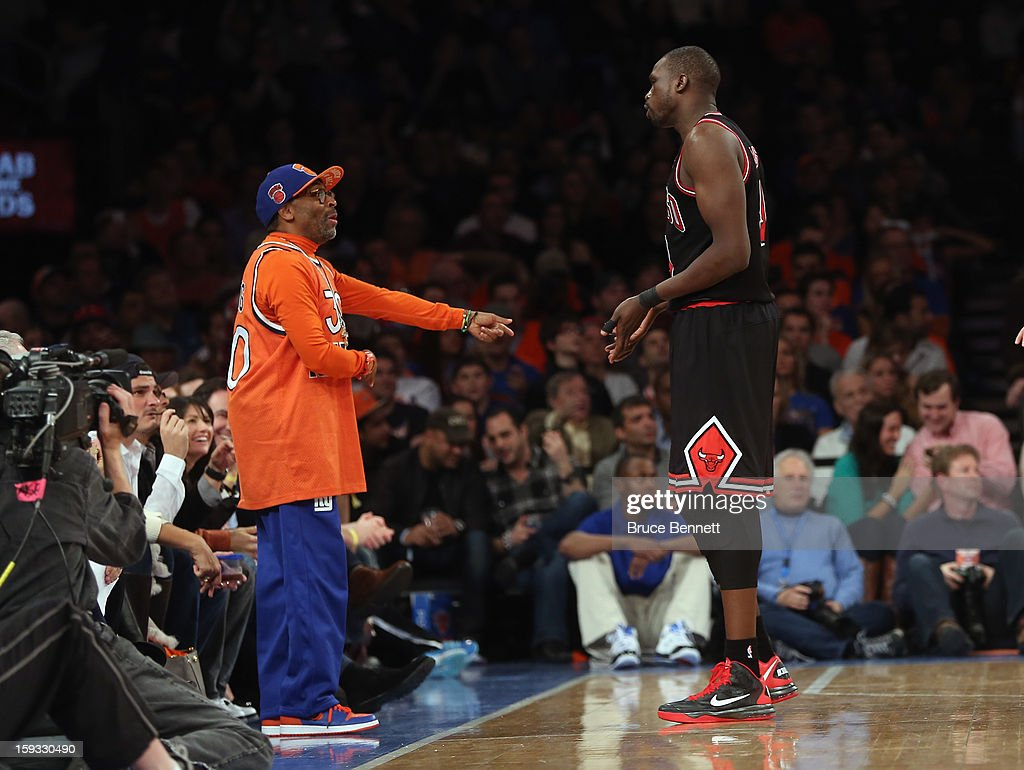 Director Spike Lee and Luol Deng #9 of the Chicago Bulls chat during the fourth quarter in the game against the New York Knicks at Madison Square Garden on January 11, 2013 in New York City.