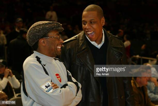 Director Spike Lee and rapper JayZ talk courtside at the New York Knicks versus Orlando Magic NBA game at Madison Square Garden on December 3 2004 in...