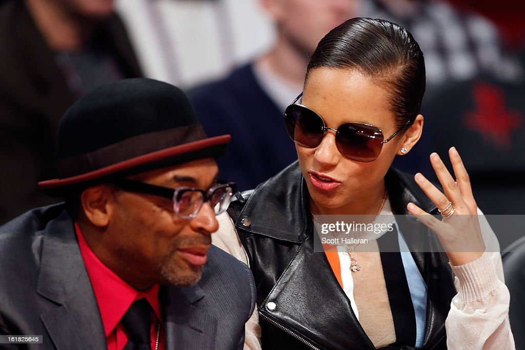 Director Spike Lee and singer Alicia Keys talk during the Taco Bell Skills Challenge part of 2013 NBA All-Star Weekend at the Toyota Center on February 16, 2013 in Houston, Texas.