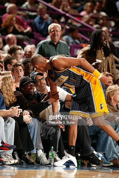 Director Spike Lee and talks with Reggie Miller of the Indiana Pacers as the Pacers play the New York Knicks during NBA action on November 15 2003 at...