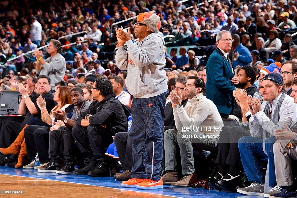 Director Spike Lee celebrates during a game between the Atlanta Hawks and New York Knicks at Madison Square Garden on January 27, 2013 in New York, New York.