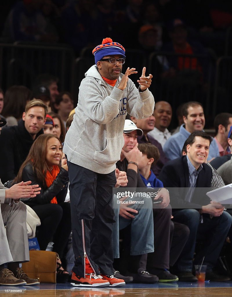 Director Spike Lee cheers for his team in the game between the New York Knicks and the Phoenix Suns at Madison Square Garden on December 2, 2012 in New York City.