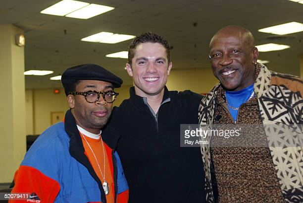 Director Spike Lee NY Mets third baseman David Wright and actor Louis Gossett Jr pose at the Cleveland Caveliers v New York Knicks NBA game at...