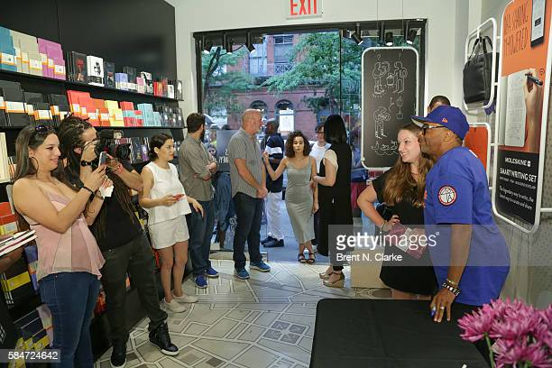 Director Spike Lee poses for photographs with a fan during the celebration of the 30th anniversary of 'She's Gotta Have It' book signing held at the...