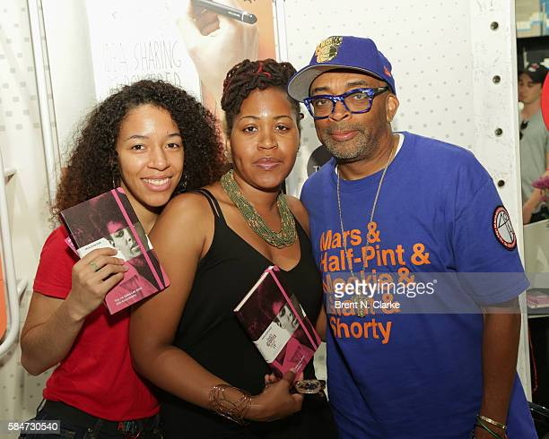 Director Spike Lee poses for photographs with fans during the celebration of the 30th anniversary of 'She's Gotta Have It' book signing held at the...