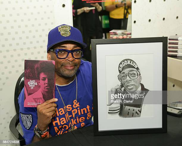 Director Spike Lee poses with a portrait from a fan during his 30th anniversary celebration of 'She's Gotta Have It' book signing held at the...