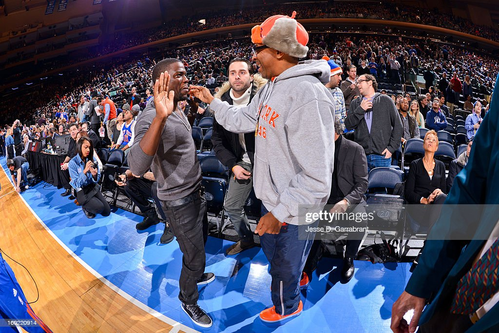 Director Spike Lee, right, greets comedian Kevin Hart before a game between the Atlanta Hawks and New York Knicks at Madison Square Garden on January 27, 2013 in New York, New York.
