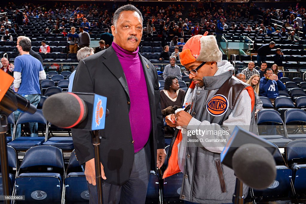 Director Spike Lee, right, speaks to Reverend Jesse Jackson before a game between the Atlanta Hawks and New York Knicks at Madison Square Garden on January 27, 2013 in New York, New York.