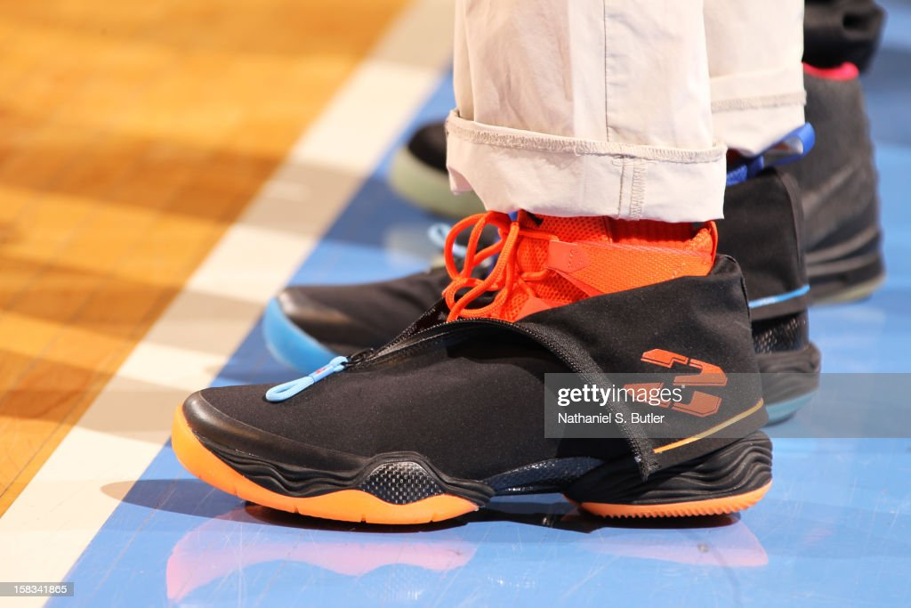 Director Spike Lee sports the Air Jordan XX8 sneakers in support of the New York Knicks on December 13, 2012 at Madison Square Garden in New York City.