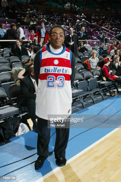 Director Spike Lee stands for a picture as he wears a throwback Michael Jordan Washington Wizards jersey prior to the NBA game between the New York...