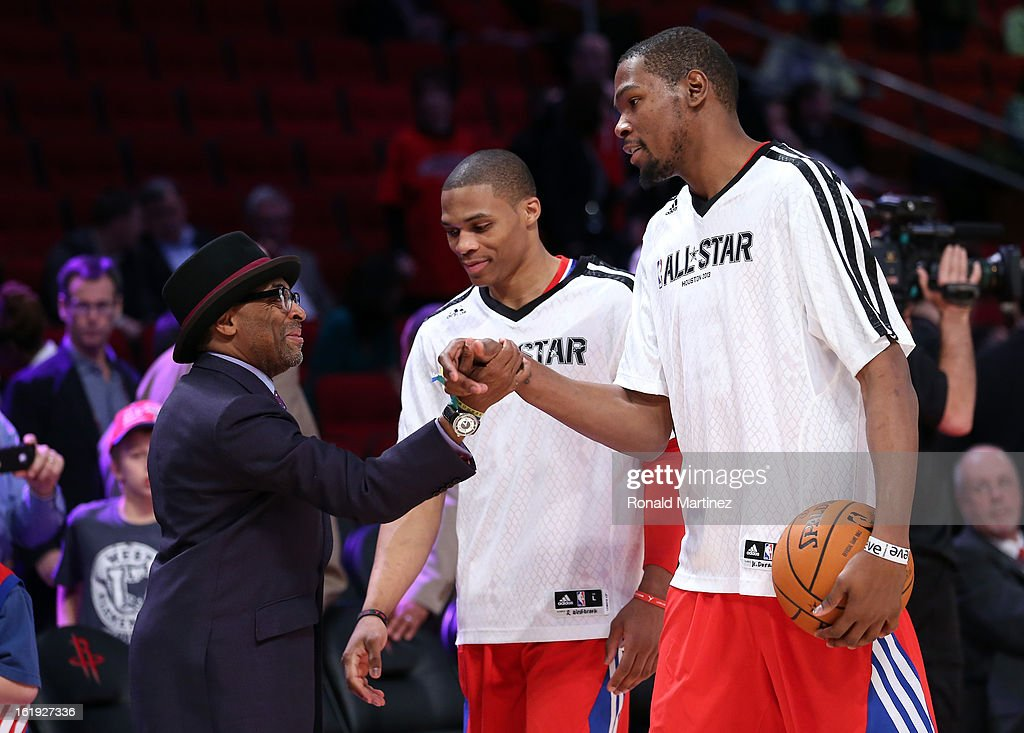 Director Spike Lee talks with Russell Westbrook #0 and Kevin Durant #35 of the Oklahoma City Thunder and the Western Conference before the 2013 NBA All-Star game at the Toyota Center on February 17, 2013 in Houston, Texas.