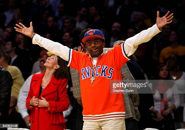 Director Spike Lee waves to the crowd during the game between the Los Angeles Lakers and the New York Knicks at Staples Center December 16 2008 in...