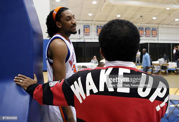 Director Spike Lee wearing a shirt that reads 'Wake up' on the back hangs out with New York Knicks' Renaldo Balkman during the team's annual media...