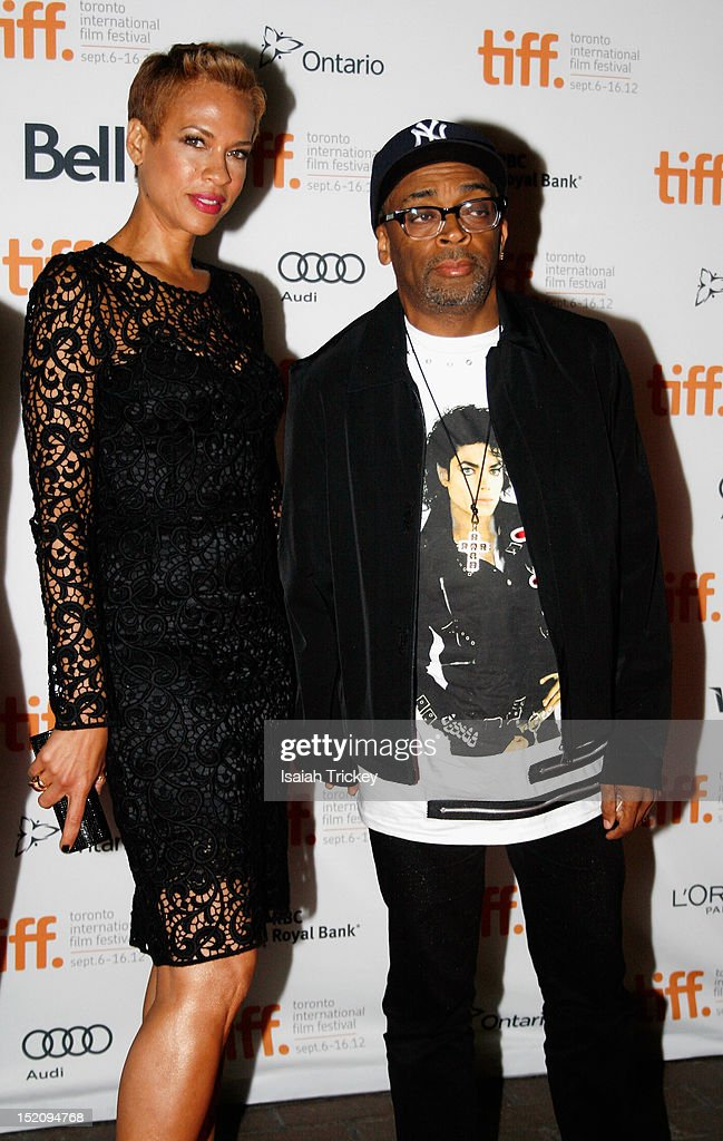 Director <a gi-track='captionPersonalityLinkClicked' href=/galleries/search?phrase=Spike+Lee&family=editorial&specificpeople=156419 ng-click='$event.stopPropagation()'>Spike Lee</a> (R) with wife <a gi-track='captionPersonalityLinkClicked' href=/galleries/search?phrase=Tonya+Lewis+Lee&family=editorial&specificpeople=591625 ng-click='$event.stopPropagation()'>Tonya Lewis Lee</a> attend the 'Bad 25' Premiere during the 2012 Toronto International Film Festival