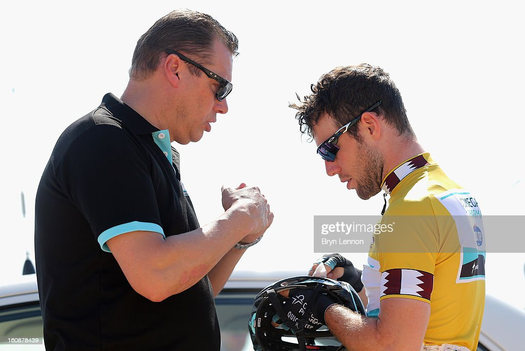 Director Sportif Wilfred Peters chats to race Leader Mark Cavendish of Great Britain and Omega Pharma - Quick Step at the start of stage five of the 2013 Tour of Qatar from Al Zubara Fort to Madinat Al Shamal on February 7, 2013 in Al Zubara Fort, Qatar.
