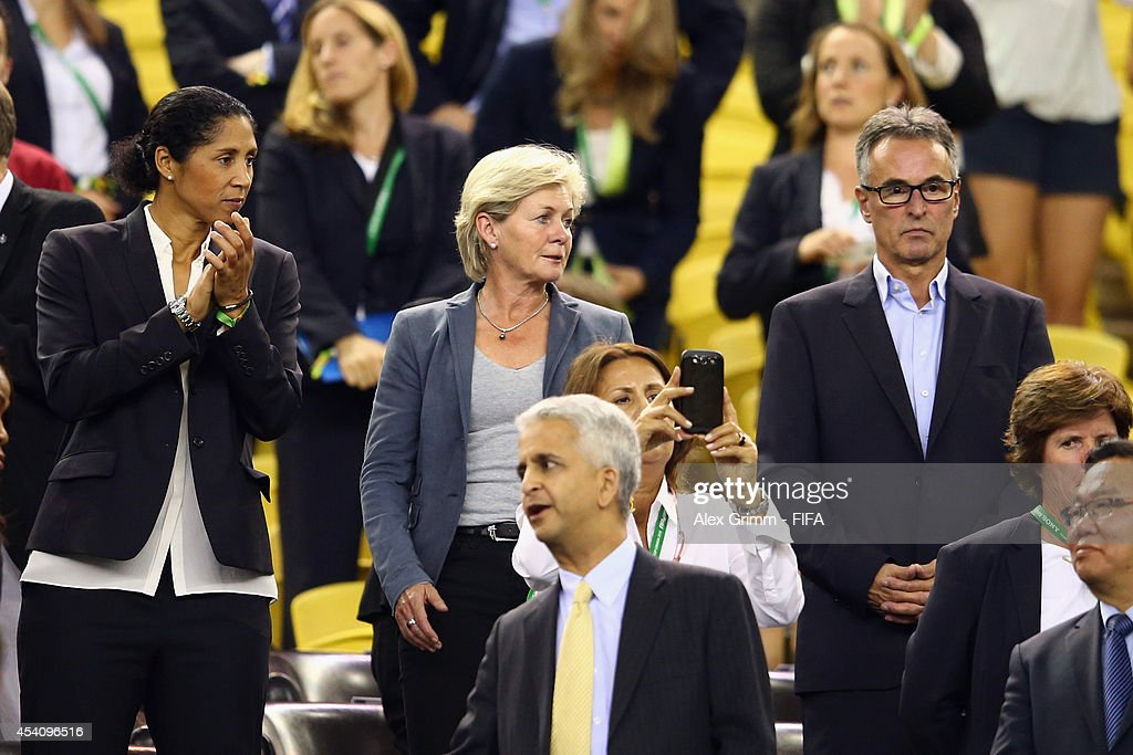 DFB director Steffi Jones, Silvia Neid, head coach of the German women's team and DFB Secretary General Helmut Sandrock (L-R) stand in the tribune prior to the FIFA U-20 Women's World Cup Canada 2014 final match between Nigeria and Germany at Olympic Stadium on August 24, 2014 in Montreal, Canada.