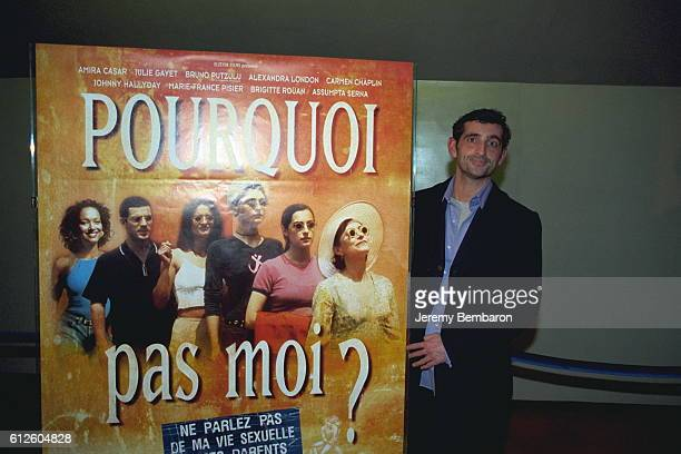 Director Stephane Giusti with the poster of the movie at the UGC Cine Cite Bercy cinema