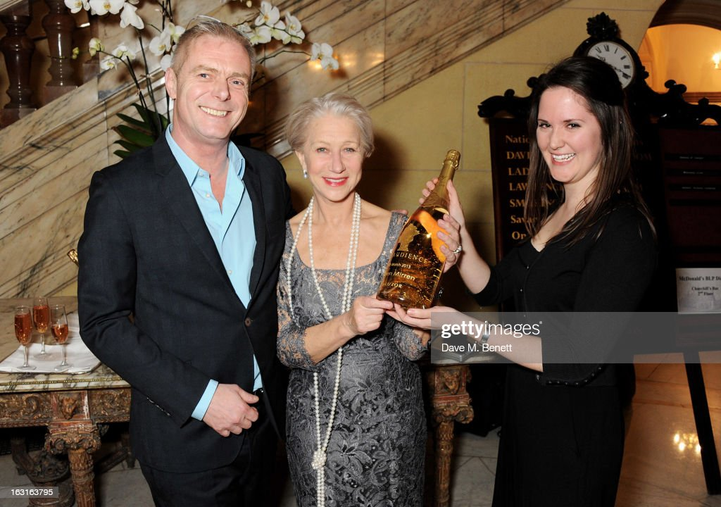 Director Stephen Daldry (L) and Dame Helen Mirren are presented a custom bottle of Luxor champagne at an after party following the press night performance of 'The Audience' at One Whitehall Place on March 5, 2013 in London, England.