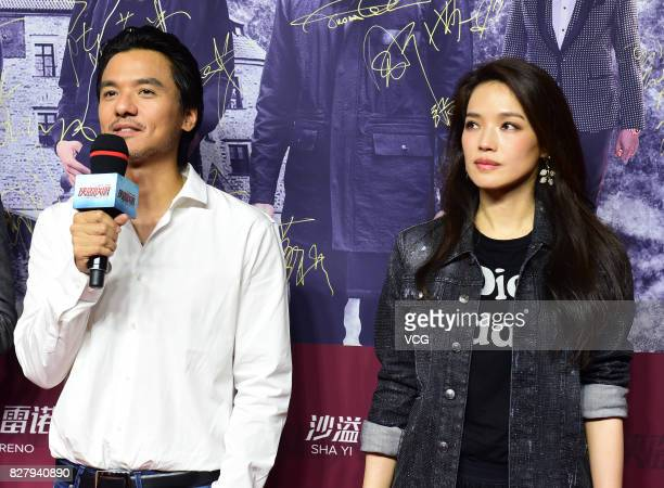 Director Stephen Fung and actress Shu Qi arrive at the red carpet of the premiere of 'The Adventurers' on August 8 2017 in Beijing China