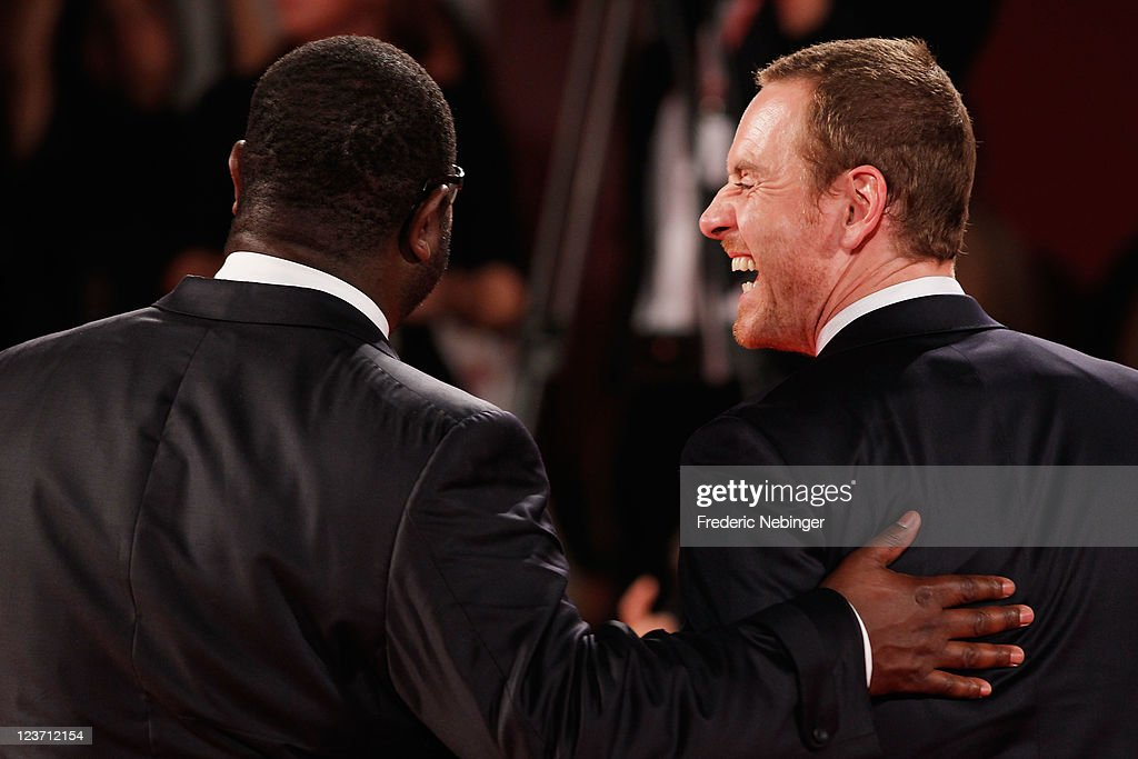 Director Steve McQueen and actor <a gi-track='captionPersonalityLinkClicked' href=/galleries/search?phrase=Michael+Fassbender&family=editorial&specificpeople=4157925 ng-click='$event.stopPropagation()'>Michael Fassbender</a> attend the 'Shame' premiere during the 68th Venice Film Festival at Palazzo del Cinema on September 4, 2011 in Venice, Italy.