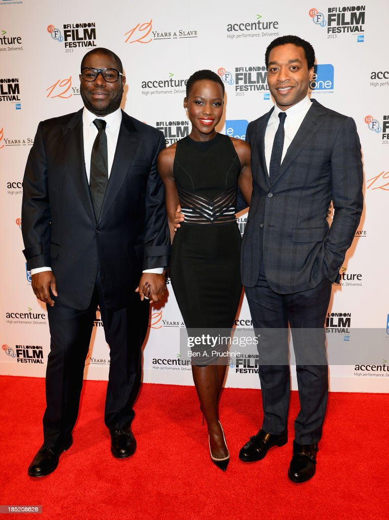 Director Steve McQueen and actors <a gi-track='captionPersonalityLinkClicked' href=/galleries/search?phrase=Lupita+Nyong%27o&family=editorial&specificpeople=10961876 ng-click='$event.stopPropagation()'>Lupita Nyong'o</a> and <a gi-track='captionPersonalityLinkClicked' href=/galleries/search?phrase=Chiwetel+Ejiofor&family=editorial&specificpeople=213998 ng-click='$event.stopPropagation()'>Chiwetel Ejiofor</a> attend the Accenture Gala ahead of the premiere of 'Twelve Years A Slave' during the 57th BFI London Film Festival at the Langham Hotel on October 18, 2013 in London, England.