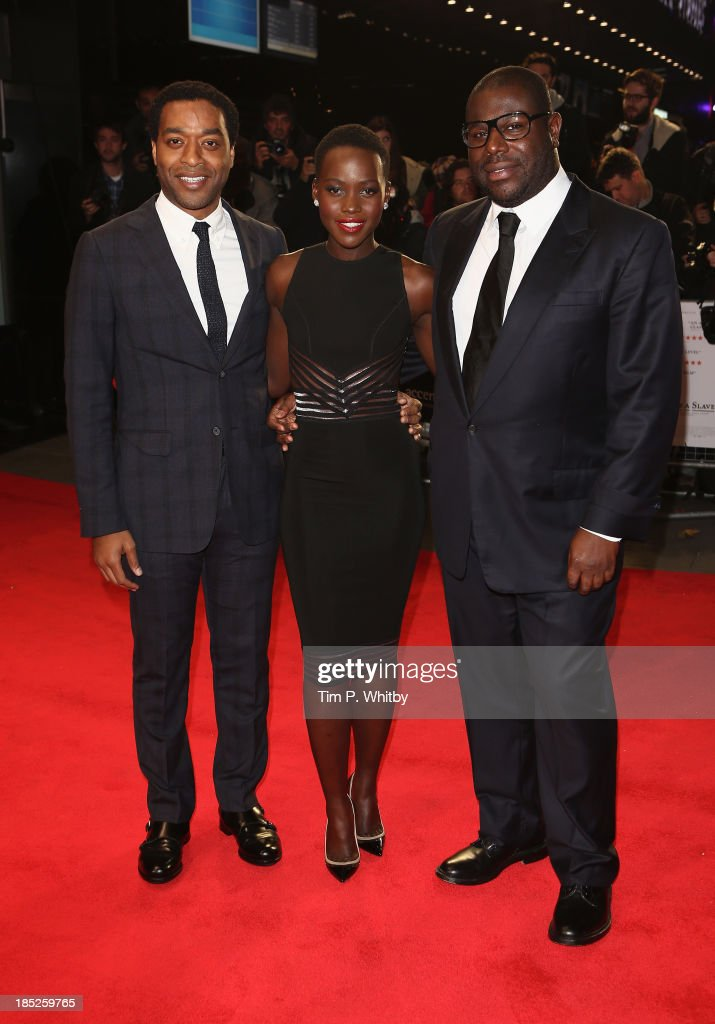 Director Steve McQueen and actors <a gi-track='captionPersonalityLinkClicked' href=/galleries/search?phrase=Lupita+Nyong%27o&family=editorial&specificpeople=10961876 ng-click='$event.stopPropagation()'>Lupita Nyong'o</a> and <a gi-track='captionPersonalityLinkClicked' href=/galleries/search?phrase=Chiwetel+Ejiofor&family=editorial&specificpeople=213998 ng-click='$event.stopPropagation()'>Chiwetel Ejiofor</a> attend the European Premiere of 'Twelve Years A Slave' during the 57th BFI London Film Festival at Odeon Leicester Square on October 18, 2013 in London, England.