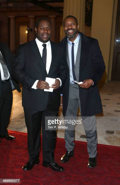 Director Steve McQueen and Lenny Henry attend a Dramatic Arts Reception at Buckingham Palace on February 17 2014 in London England