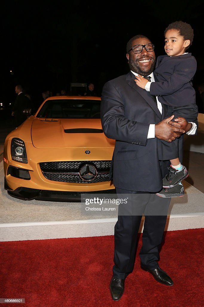 Director <a gi-track='captionPersonalityLinkClicked' href=/galleries/search?phrase=Steve+McQueen+-+Film+Director&family=editorial&specificpeople=7080077 ng-click='$event.stopPropagation()'>Steve McQueen</a> (L) arrives in style during the Mercedes-Benz arrivals at the 25th Annual Palm Springs International Film Festival Awards Gala onJanuary 4, 2014 in Palm Springs, California.