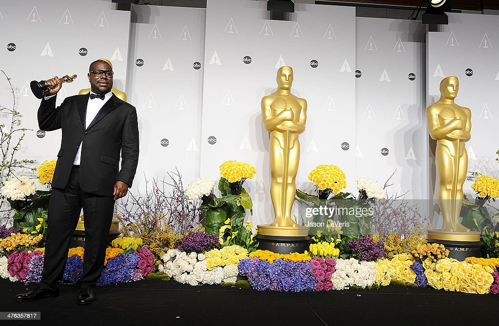 Director Steve McQueen poses in the press room at the 86th annual Academy Awards at Dolby Theatre on March 2, 2014 in Hollywood, California.