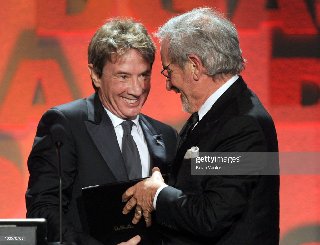 Director Steven Spielberg (R) accepts the Feature Film Nomination Plaque for 'Lincoln' from actor Martin Short (L) onstage during the 65th Annual Directors Guild Of America Awards at Ray Dolby Ballroom at Hollywood & Highland on February 2, 2013 in Los Angeles, California.