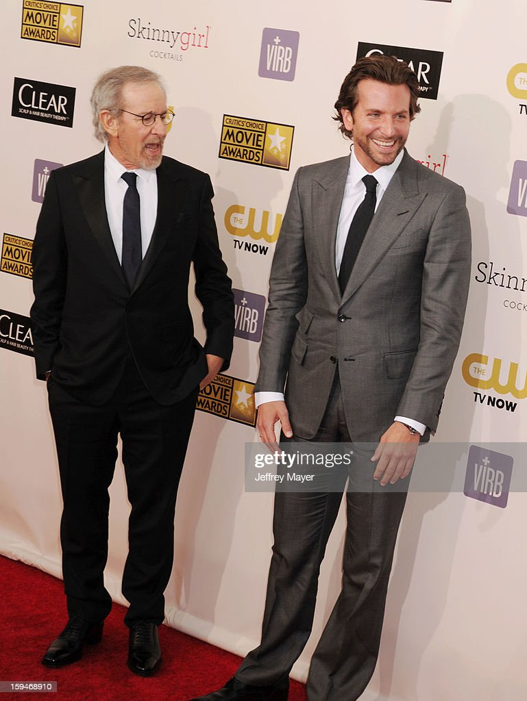Director Steven Spielberg and actor Bradley Cooper arrive at the 18th Annual Critics' Choice Movie Awards at The Barker Hanger on January 10, 2013 in Santa Monica, California.