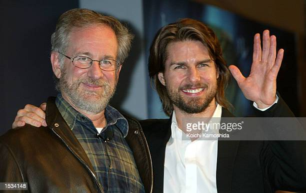 Director Steven Spielberg and actor Tom Cruise pose during a photo shoot while promoting their latest movie 'Minority Report' October 26 2002 in...