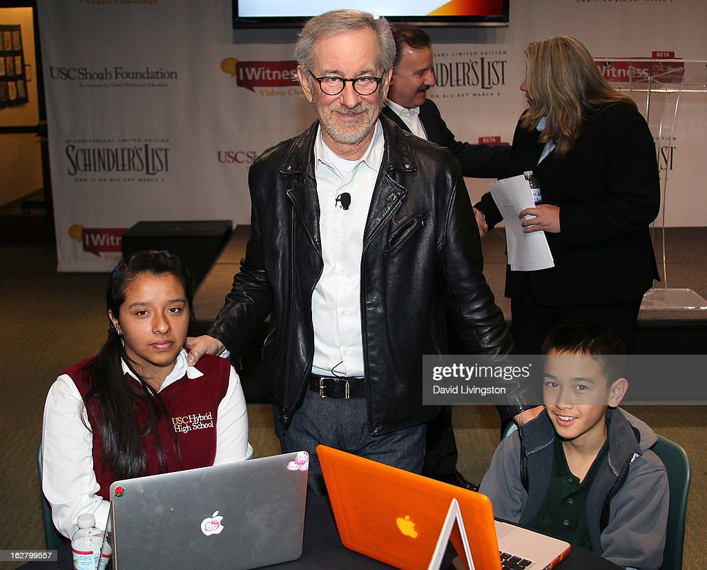 Director <a gi-track='captionPersonalityLinkClicked' href=/galleries/search?phrase=Steven+Spielberg&family=editorial&specificpeople=202022 ng-click='$event.stopPropagation()'>Steven Spielberg</a> (C) and students attend the 'Schindler's List' 20th Anniversary Limited Edition DVD/Blu-ray & USC Shoah Foundation's IWitness Video Challenge launch event at The Chandler School on February 27, 2013 in Pasadena, California.