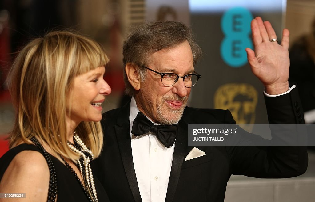 US director Steven Spielberg (R) and wife Kate Capshaw pose on arrival for the BAFTA British Academy Film Awards at the Royal Opera House in London on February 14, 2016. TALLIS