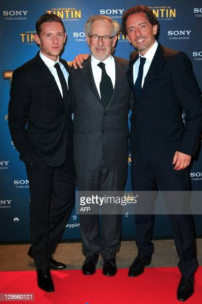 US director Steven Spielberg poses with French actor Gad Elmaleh and British Actor Jamie Bell during a photocall on October 22 2011 in Paris prior to...