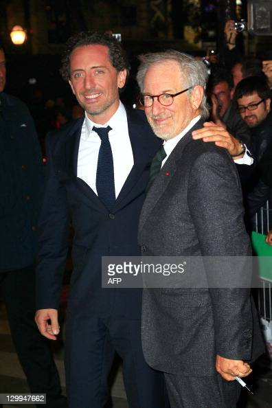 US director Steven Spielberg poses with French actor Gad Elmaleh during a photocall on October 22 2011 in Paris prior to the premiere of the...