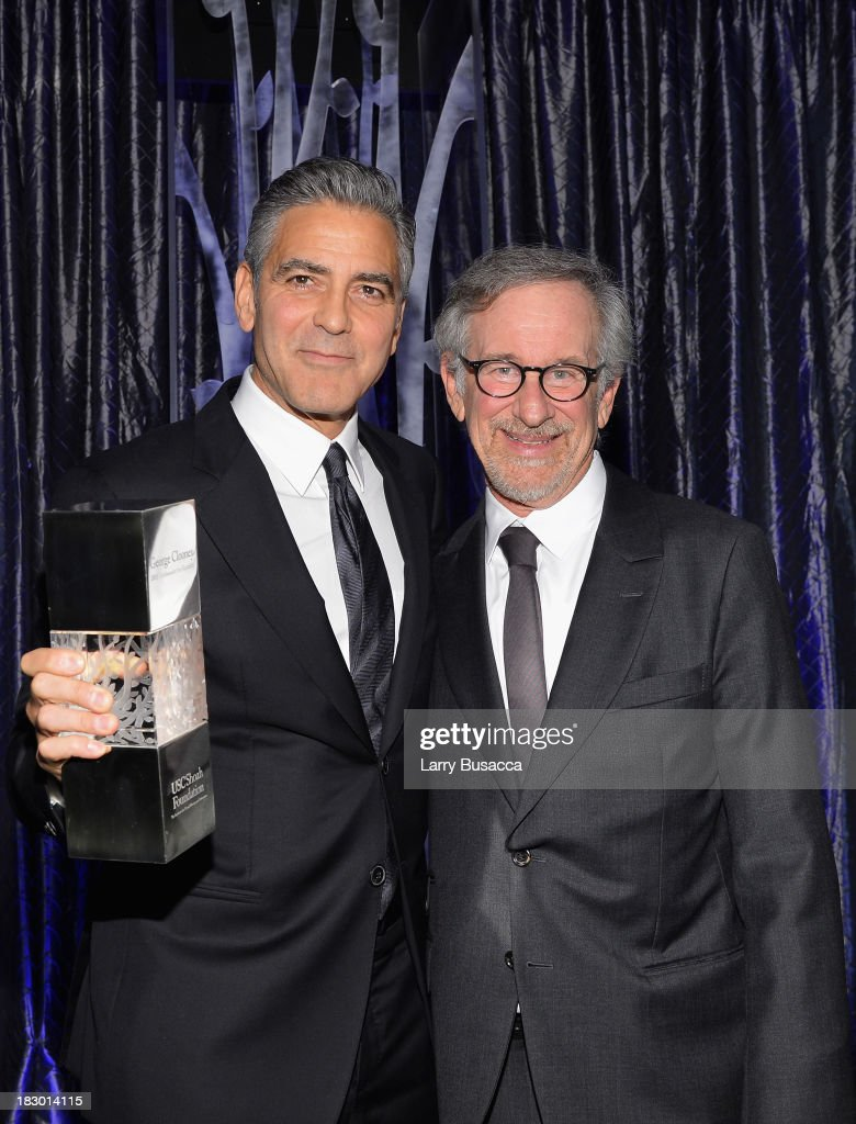 Director <a gi-track='captionPersonalityLinkClicked' href=/galleries/search?phrase=Steven+Spielberg&family=editorial&specificpeople=202022 ng-click='$event.stopPropagation()'>Steven Spielberg</a> (R) presents honoree <a gi-track='captionPersonalityLinkClicked' href=/galleries/search?phrase=George+Clooney&family=editorial&specificpeople=202529 ng-click='$event.stopPropagation()'>George Clooney</a> with the USC Shoah Foundation's Ambassador for Humanity Award at the USC Shoah Foundation Institute 2013 Ambassadors for Humanity gala at the American Museum of Natural History on October 3, 2013 in New York, New York.