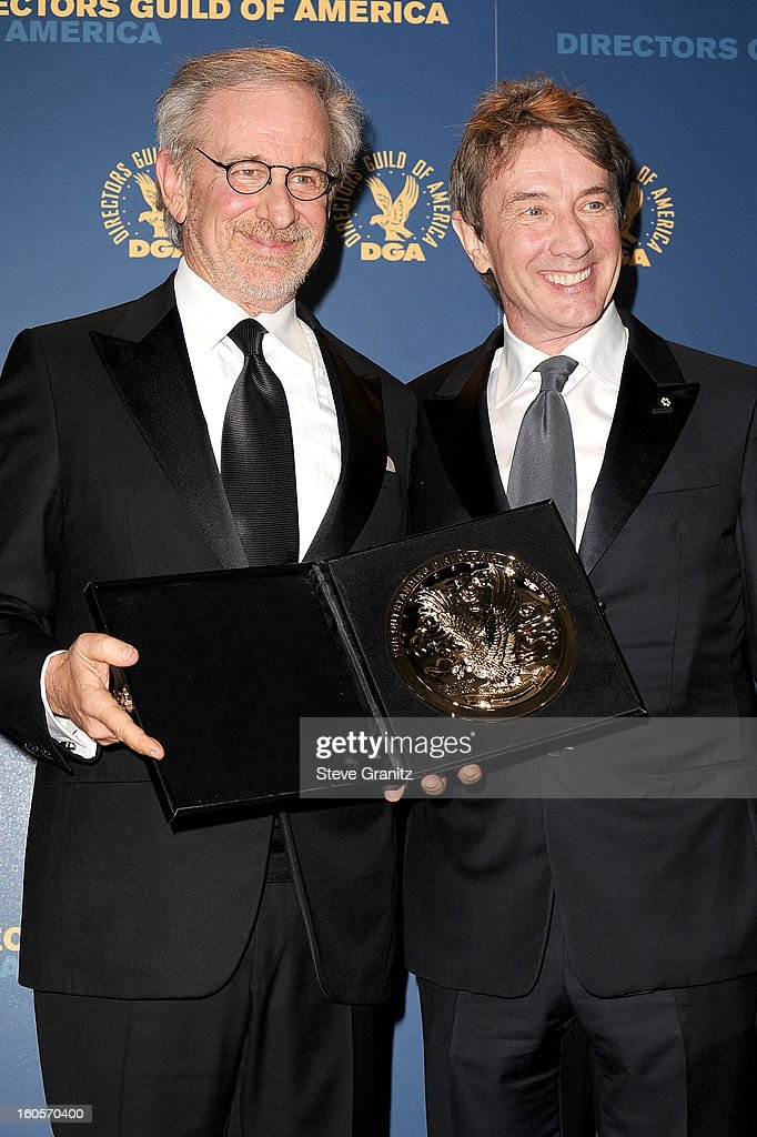 Director Steven Spielberg (L), recipient of the Feature Film Nomination Plaque for Lincoln,' and presenter Martin Short pose in the press room at the 65th Annual Directors Guild Of America Awards at The Ray Dolby Ballroom at Hollywood & Highland Center on February 2, 2013 in Hollywood, California.