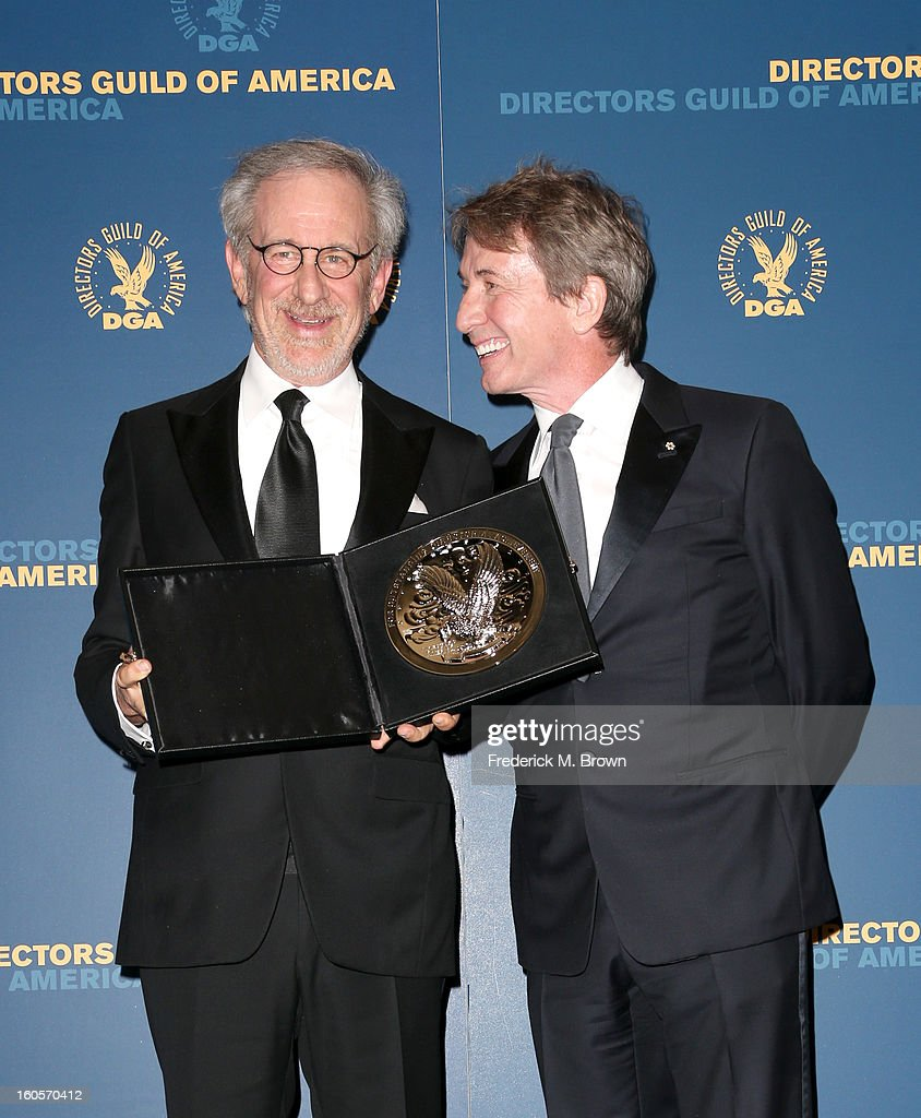 """Director Steven Spielberg (L), recipient of the Feature Film Nomination Plaque for """"Lincoln,' and presenter Martin Short pose in the press room during the 65th Annual Directors Guild Of America Awards at Ray Dolby Ballroom at Hollywood & Highland on February 2, 2013 in Los Angeles, California."""