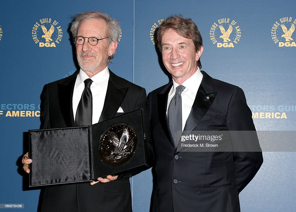 "Director Steven Spielberg (L), recipient of the Feature Film Nomination Plaque for ""Lincoln,' and presenter Martin Short pose in the press room during the 65th Annual Directors Guild Of America Awards at Ray Dolby Ballroom at Hollywood & Highland on February 2, 2013 in Los Angeles, California."