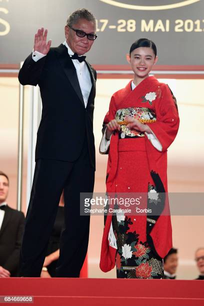 Director Takashi Miike and Hana Sugisaki attend the 'Blade Of The Immortal ' premiere during the 70th annual Cannes Film Festival at Palais des...