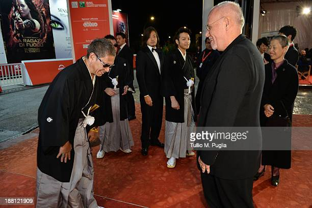 Director Takashi Miike meets Rome Film Festival director Marco Muller as they attend the 'The Mole Song' Premiere during The 8th Rome Film Festival...