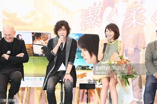 Director Takehiko Shinjo actress Masami Nagasawa and singer Kazuyoshi Saito attend 'Beyond the Memories' stage greeting during the 26th Tokyo...