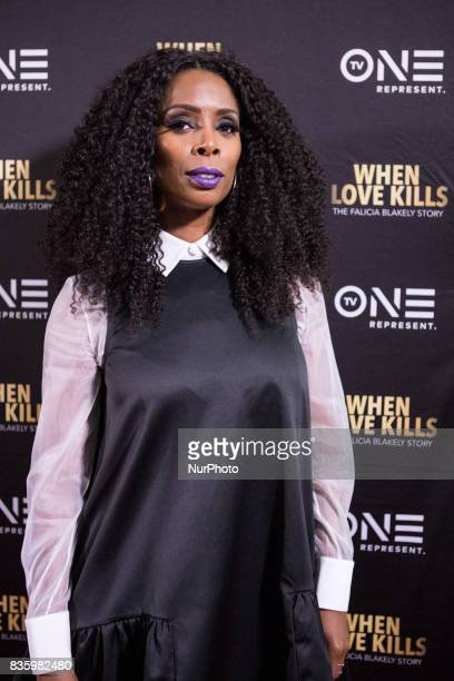 Director Tasha Smith poses for a photo on the red carpet at TV One's DC Premiere of When Love Kills The Falicia Blakely Story at the Newton White...