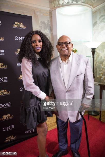 Director Tasha Smith poses for a photo on the red carpet with her friend and mentor actor Charles S Dutton at TV One's DC Premiere of When Love Kills...