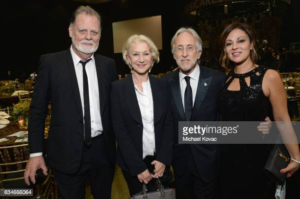 Director Taylor Hackford actress Helen Mirren President/CEO of MusiCares and The Recording Academy Neil Portnow and Michele Tebbe attend MusiCares...