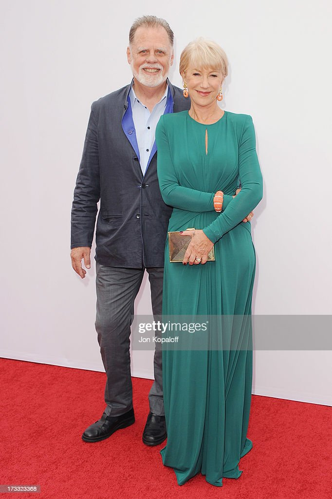 Director Taylor Hackford and wife actress Helen Mirren arrive at the Los Angeles Premiere 'Red 2' at Westwood Village on July 11, 2013 in Los Angeles, California.