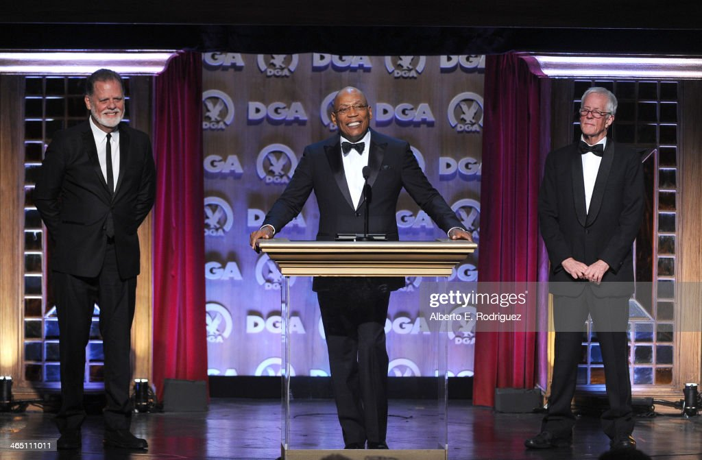Director Taylor Hackford, DGA President Paris Barclay and director Michael Apted speak onstage at the 66th Annual Directors Guild Of America Awards held at the Hyatt Regency Century Plaza on January 25, 2014 in Century City, California.