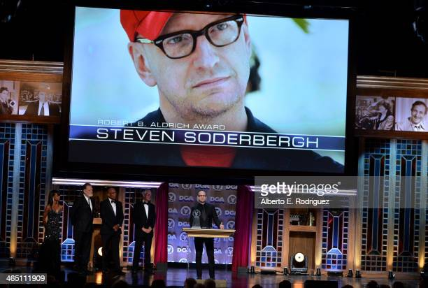 Director Taylor Hackford DGA President Paris Barclay director Michael Apted stand onstage as director Steven Soderbergh accepts the Robert B Aldrich...